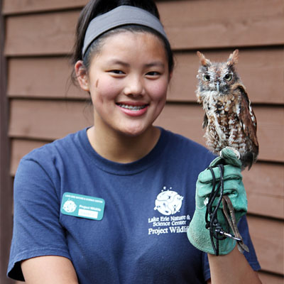 Project Wildlife student holding Screech Owl